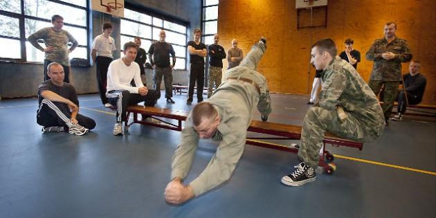 Lower Acrobatics. Falling With a Slide Legs Forward